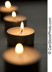 tea lights - several tea lights with wooden background