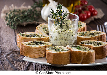 Portion of Garlic Bread on wooden background