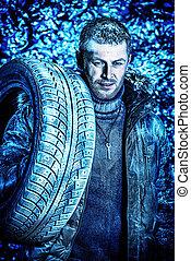 snowbound - Handsome brutal man dressed in winter clothes...