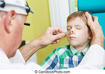 Little boy at ear nose thoat doctor