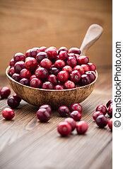 Cranberries. - Cranberries in wooden bowl on wooden...