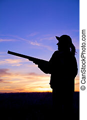 Hunter With Shotgun at Sunrise - a hunter with shotgun...