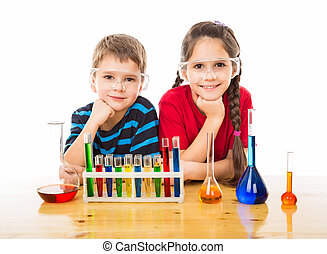 Two kids with chemical equipment - Two smiling kids on the...