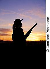 Hunter With Shotgun at Sunrise - a hunter with shotgun...