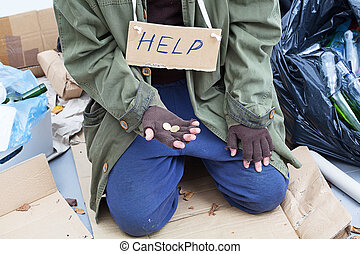 Poor homeless beggar on the street
