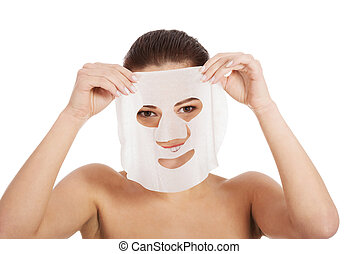 Beautiful woman with collagen mask Isolated on white