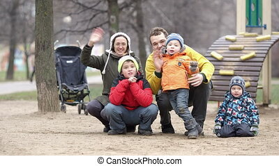 Family of five waving with the hands. - Happy mother, father...