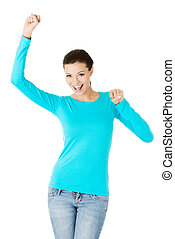 beautiful casual woman with raised fists.