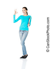 beautiful casual woman holding  files and showing OK.