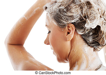 Beautiful woman taking a shower and shampooing her hair....