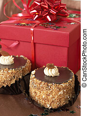 Miniature chocolate cakes and gifts