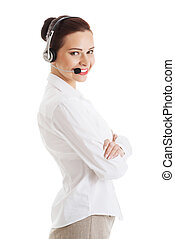 Beautiful woman on call center with microphone and...