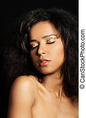 Beautiful mulatto woman with tiger make up. Over black...