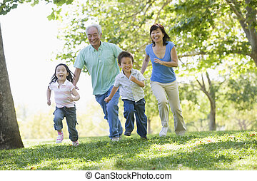Grandparents running with grandchildren.