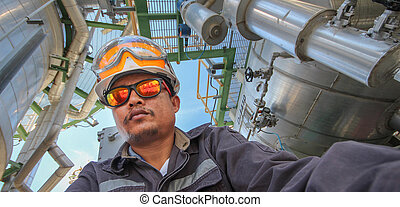 Engineer in refinery plant - A man with personal protection...
