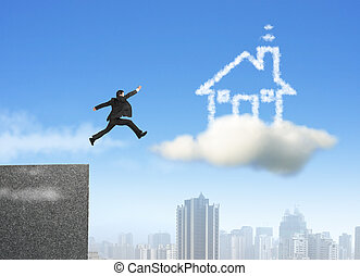 Businessman running and jumping on cloud dream house with...