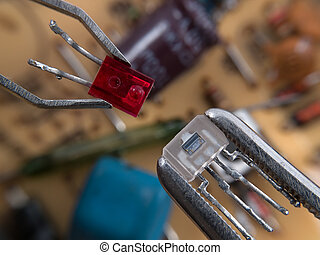 Electronic assembly - Optocoupler and LED in pincers...