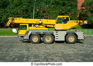 Automobile crane - Big yellow automobile crane with...