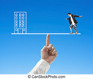 Businessman surfing on seesaw with Office, for index finger...