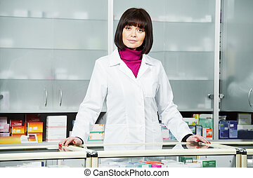 Pharmaceutical chemist woman in drugstore - cheerful...