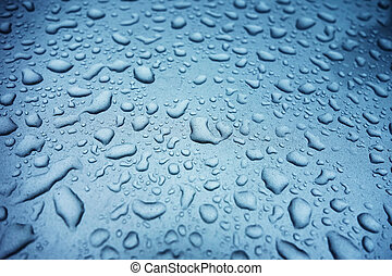 Water drops on blue