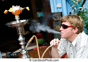 Man smoking a hookah - Man smoking a traditional Middle...