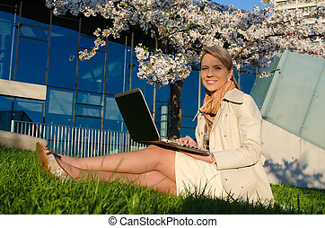 Young woman with laptop - Young pretty woman with laptop