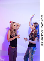 women standing in a row toasting - Group stylish women...