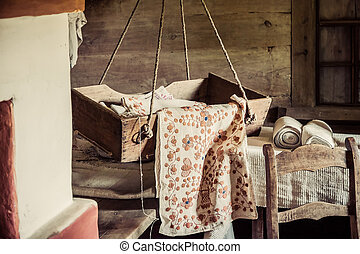 Old Craddle - cradle antique in an old wooden farm house