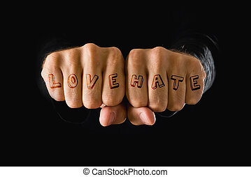 Love and hate tattooes, hands clenched in fist - Love and...