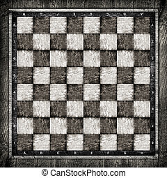 Old wooden chess board in black and white.
