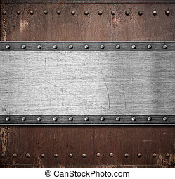 old metal plate over rusty background with rivets