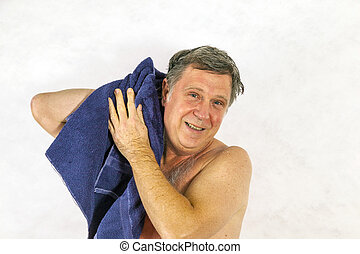 Man toweling hair after shower - Man toweling hair after...