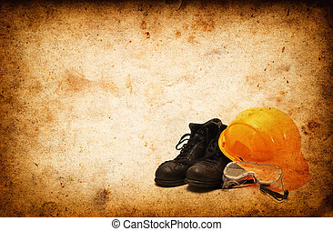 Safety equipment for construction industry on Vintage grunge...