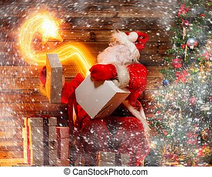 Santa Claus in wooden home interior holding gift box with magic star flying out of it