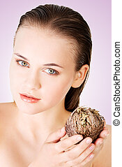 Beautiful woman holding Rose of Jericho - Beautiful spa...