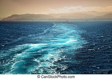 Foamy track behind the stern of the ship overlooking the...