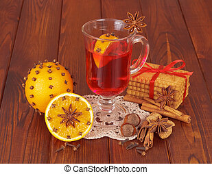 Glass of mulled wine on napkin and orange - Glass of mulled...