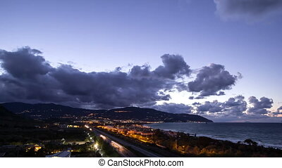 Sunset over the coast of Sicily. Patti, Italy. Time Lapse