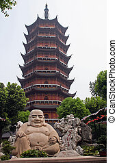 Smiling buddha statue in front of a distorted Ruigang...