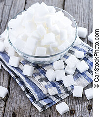 White Sugar on vintage wooden table (close-up image)