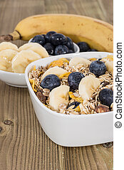 Breafkast on wooden background - Breakfast consisting of...