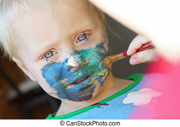 Young Child Getting Face Painted