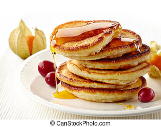 stack of pancakes on white plate - stack of pancakes with...
