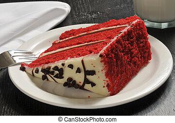 Red velvet cake - A slice of red velvet cake with a glass of...