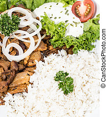Kebab with Rice (macro shot) - Kebab with Rice and Sauce...