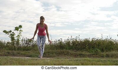 Girl training outdoor. - Young girl training outdoors:...