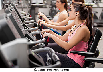 Girls on a spinning session - Cute young women doing some...