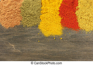 Assorted powder spices - Assorted loose powder spices on...
