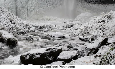 Latourell Falls Frozen in Winter along Columbia River Gorge...